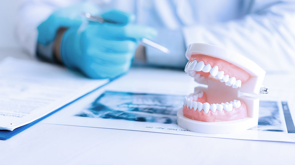 Dentist concept for children with tools in glass cup